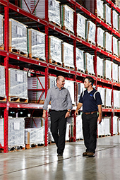 Two men walking in a warehouse